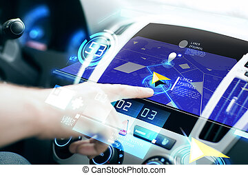 male hand using navigation system on car dashboard -...