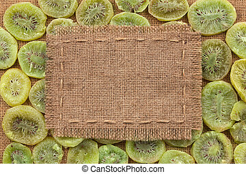 Frame made of burlap on dried kiwi, with space for your text