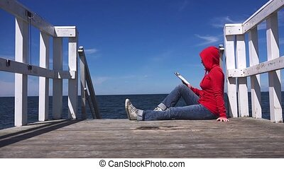 Alone Woman in Red Shirt Reading - Alone Young Woman Reading...