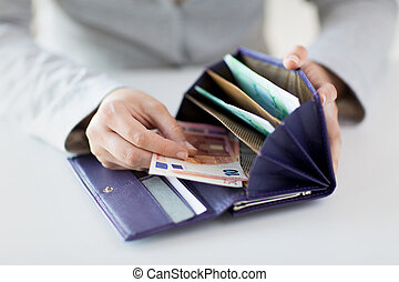 close up of woman hands with wallet and euro money -...