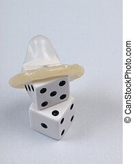 Safer Sex - Condom and dice - do not take chances with sex