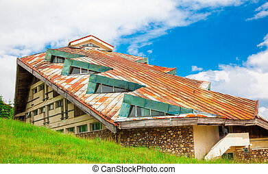Run down building in Semenic, Romania - The roof of a run...