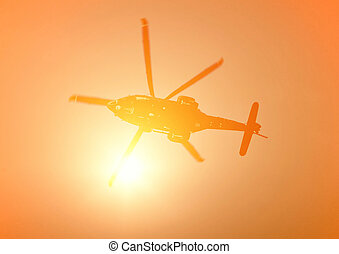 helicopter in flight - helicopter in the sky at sunset