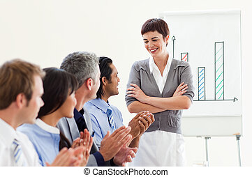 A diverse business group applauding a good presentation...