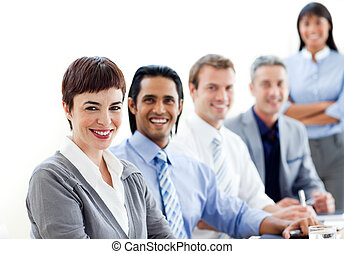 Smiling business co-workers sitting in a line