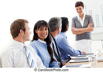 Business people showing ethnic diversity in a meeting in the...