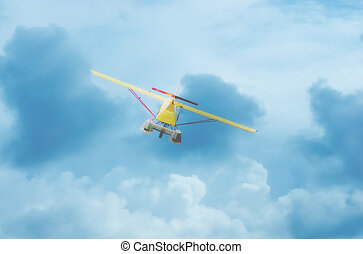 seaplane in flight with cloudy sky