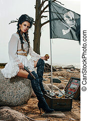 Pirate woman standing near treasure chest - Beautiful pirate...