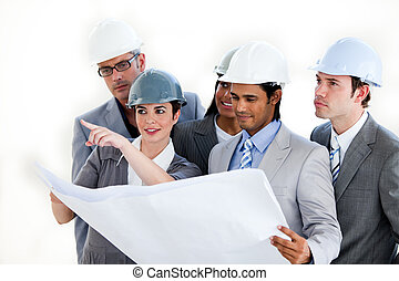 A diverse group of architects studying a plan isolated on a...