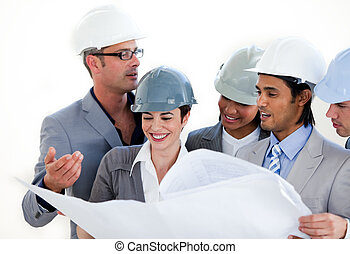 A pensive group of architects studying a plan