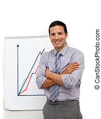 Delighted businessman with folded arms in front of a board...