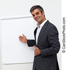 Charming businessman pointing at a board at a presentation...