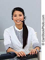 Ethnic customer service representative with headset on...