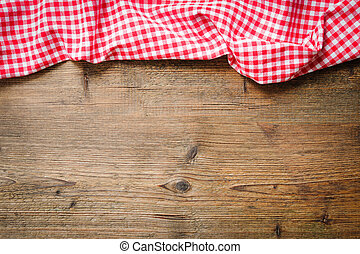 Tablecloth on wooden table - Red checkered tablecloth on...
