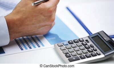 businessman hands with calculator and papers - business,...