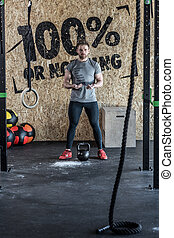 Instructor of cross fit training - Image of instructor of...