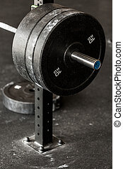 Heavy barbell weight - Close-up of heavy barbell weight at...