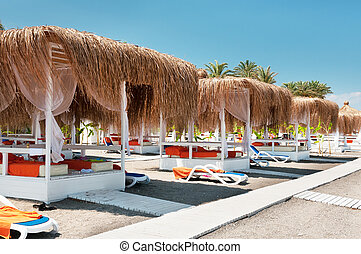 Canopies from the sun on a beach in Turkey - Canopies from...