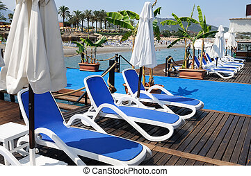 Chaise lounges from the sun on a beach