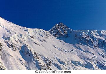 Snow capped mountains - Snow capped mountains at the sunrise...