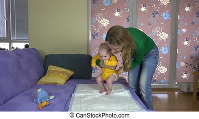 mom exercise baby - Woman with her infant baby daughter girl...