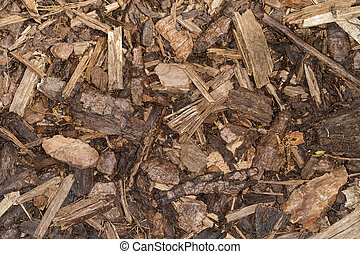Wood chips for landscaping in the gardens. nature texture...
