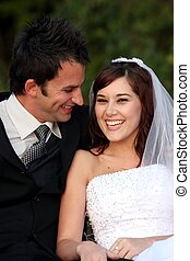 Laughing Wedding Couple - Pretty wedding couple enjoying a...