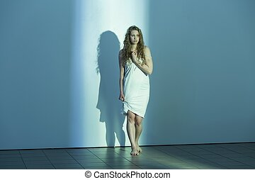 Young woman in empty room