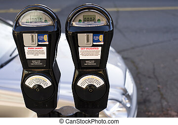 Parking Meter - Closeup of Two Parking Meters in Front of a...