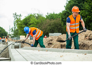 Construction workers during their work - Image of...