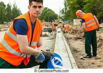 Construction worker taking break - Portrait of mature...