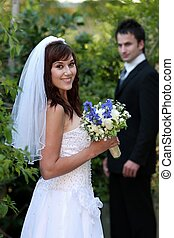 Gorgeous Wedding Couple - Beautiful smiling bride with her...