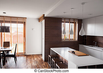 Bright kitchen with dinning room