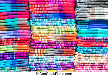 Textiles in Otavalo, Ecuador - Soft colorful blankets made...