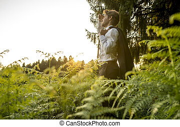 Young Man in the Forest Looking into the Distance