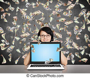 businesswoman with laptop and falling dollar bills