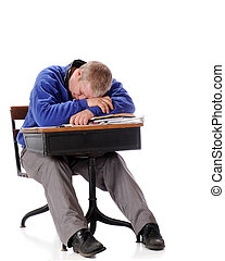 Schooltime Snooze - A mature man in an old school desk...