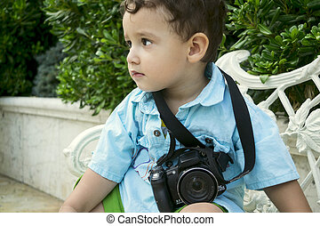 boy 2 years outdoors - boy 2 years with a camera outdoors