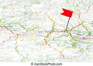Travel destination - Red color flag pin on map, shallow...