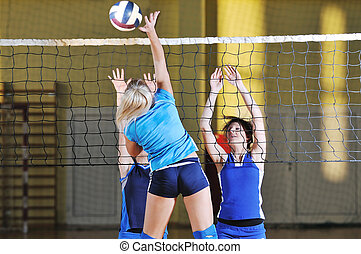 volleyball game sport with group of girls indoor in sport...