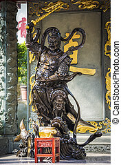 Warrior statue in Wong Tai Sin temple, Hong Kong. - Warrior...