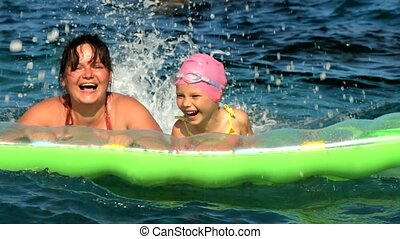 Joy And Gladness To The Sea - Mother playing with her child...