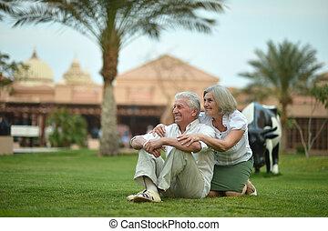 Senior couple on vacation - Amusing smiling senior couple...