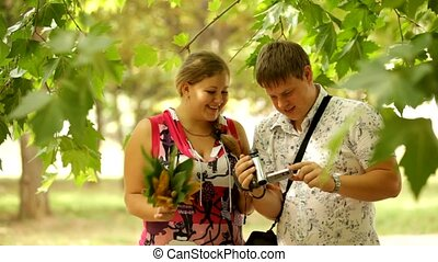 Hilarious Video On The Camcorder - Young couple watching a...