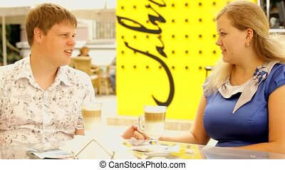 Appointment In Cafe - Young couple on a date at a cafe. Four...