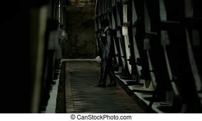 Wine Cellar - The groom is in the cellar.