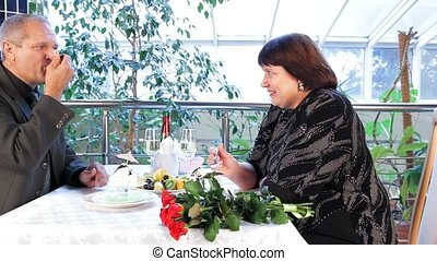 Woman Eating Dessert - Mature couple having dinner in a nice...