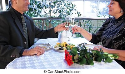 Couple In Restaurant - Mature couple having dinner in a nice...