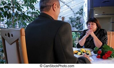 Warm Relationship - Mature couple having dinner in a nice...