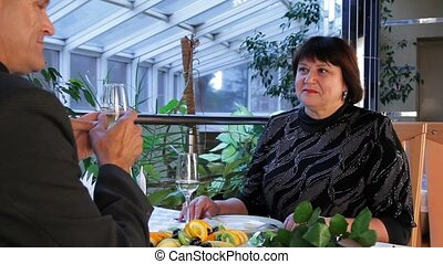 Rest At An Expensive Restaurant - Mature couple having...